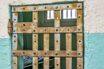 Jail cell through the bars