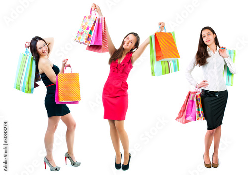 Young girls with shopping bags in hands isolated