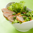 Chicken salad with lettuce, peas and corn, selective focus