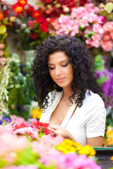 Female florist working in a greenhouse
