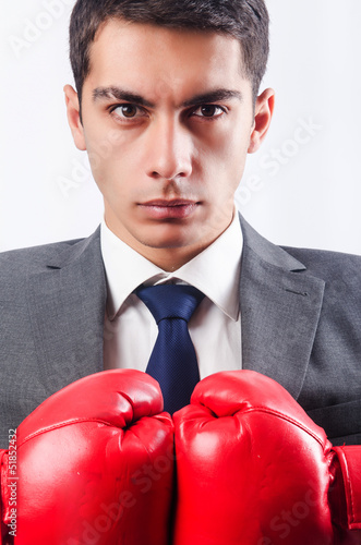Young businessman with boxing gloves