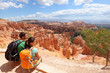 Hikers in Bryce Canyon resting enjoying view