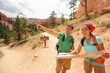 People hiking looking at hike map in Bryce Canyon