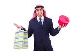 Arab man with shopping gifts on white