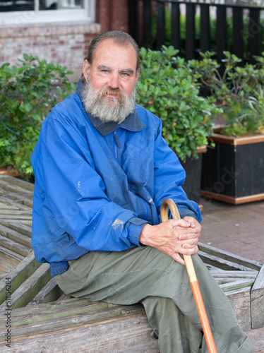 Homeless man with cane
