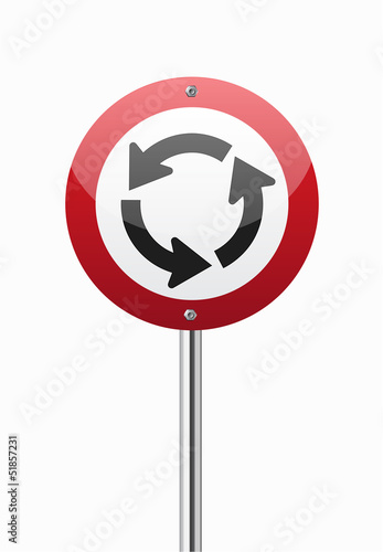 Roundabout crossroad on red traffic sign