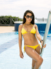 Attractive Woman by the swimming pool