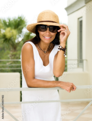 Happy young woman on a vacation at tropical resort