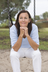 Relaxed attractive mature woman park outdoor