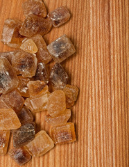 brown caramelized sugar on wooden background