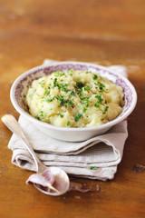 Bowl of creamy mashed potato with roasted garlic