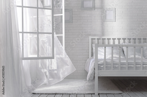 Bedroom with an open window and a light breeze on a sunny day