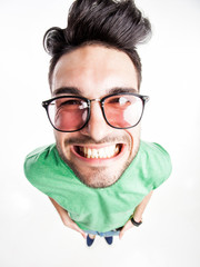 funny handsome man with hipster glasses smiling  - wide angle