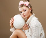 Hosiery. Teen in Handmade Woven Sweater with White Ball of Yarn