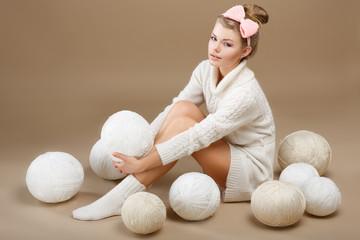 Crochet. Needlewoman with White Skeins of Yarn. Needlecraft