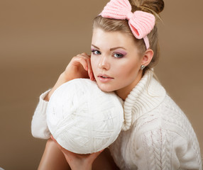 Pure Beauty. Woman in White Knitted Pullover with Hank of Thread