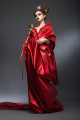 Magic. Woman Wizard in Red Pallium with Scepter. Witchcraft