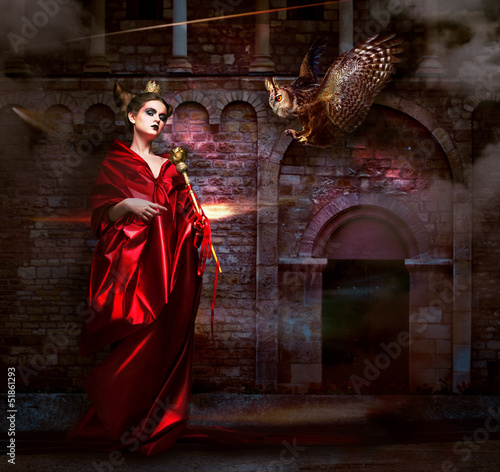 Magic.  Witchcraft. Sorcerer with Vulture Hawk. Ancient Castle