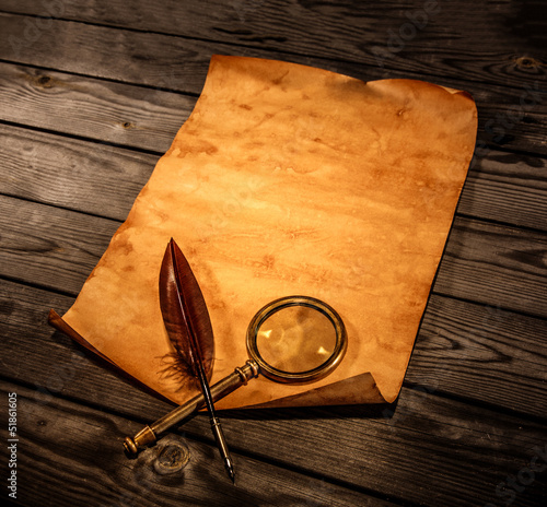 Blank old paper against the background of an aged wood