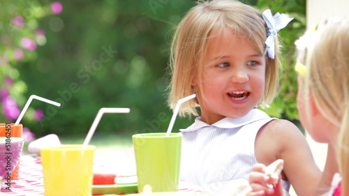Young Girl Enjoying Food At Party