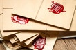 Stack of vintage envelopes with red sealant