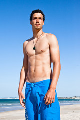 Handsome fit young man on the beach
