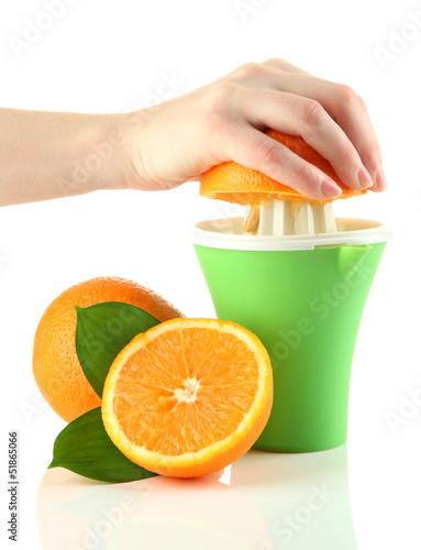 Preparing fresh orange juice squeezed with hand juicer,