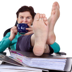 Office woman puts feet up relaxing