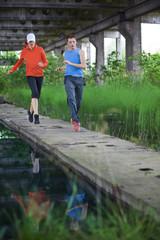 man and woman running training