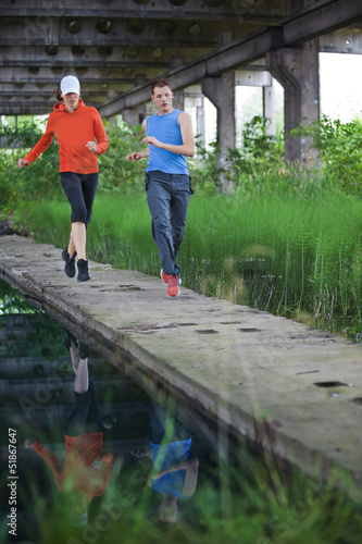 man and woman running training