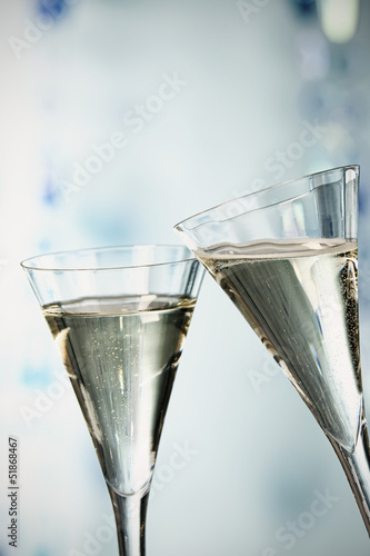 Two glasses of champagne toasting