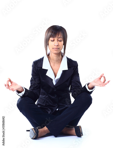 Business woman doing yoga. Isolated on white background.