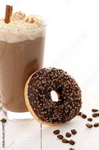 Ice coffee with whipped cream and donut