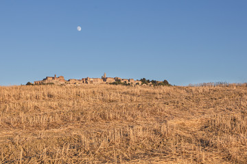 Optical illusion of a village behind the hill, Tuscany