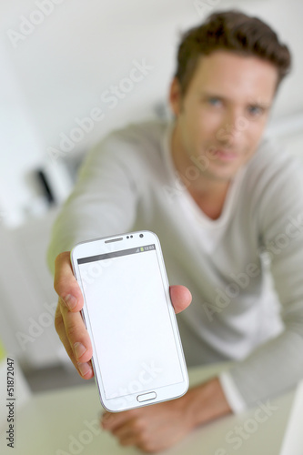 Closeup on smartphone screen held by man's hand