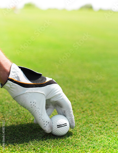 Golf player man holding golf ball