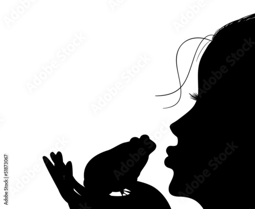 Silhouette of a young girl kisses a frog