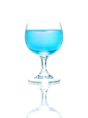 Wineglass with blue liquid, isolated on white background