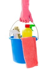 Hand holding bucket of cleaning materials