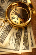Golden vintage compass and money