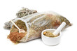 bag of healing herbs, mortar and pestle, herbal medicine