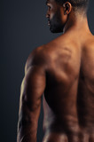 Young African American Man Flexing Triceps poster