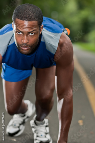 African American Athlete Running On A Wooded Path