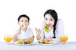 Mother and son eating healthy salad - isolated