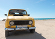 Yellow retro car by the sea