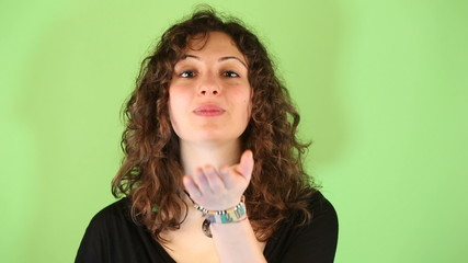 Young Woman Gesturing on Green Background