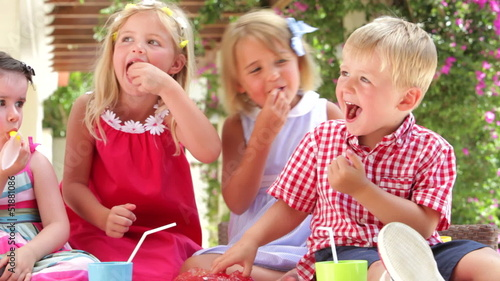 Children Enjoying Food At Party
