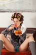 canvas print picture - sexy girl eating spaghetti on the couch