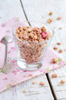 Berry muesli on rusted wooden table