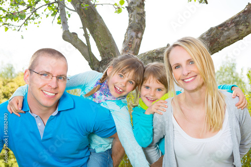 portrait of cheerfull family in nature